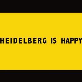 gelber Hintergrund mit schwarzer Schrift: Heidelberg is Happy