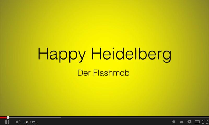 Titelbild des Videos. Text: Happy-Heidelberg Der Flashmob